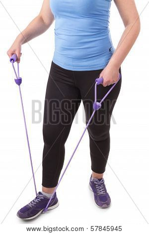 Middle-aged Woman Practicing Fitness Expanders. On A White Background.