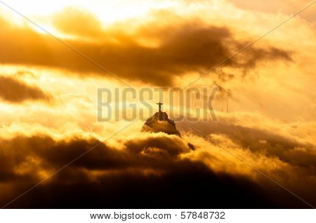 Christ the Redeemer Statue in Clouds on Sunset
