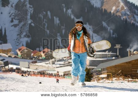 Lucky Girl Snowboarder In A Mountain Valley