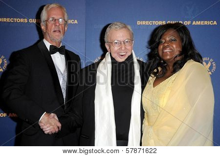 Michael Apted with Roger Ebert and wife Chaz in the press room at the 61st Annual DGA Awards. Hyatt Regency Century Plaza, Los Angeles, CA. 01-31-09
