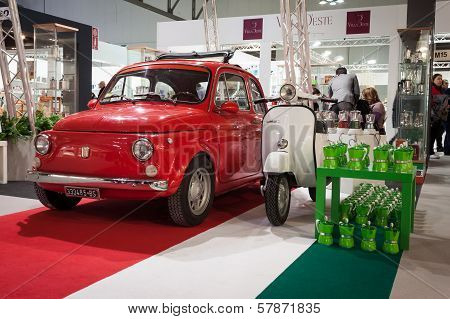 Fiat 500 Car And Vespa Scooter On Display At Homi, Home International Show In Milan, Italy