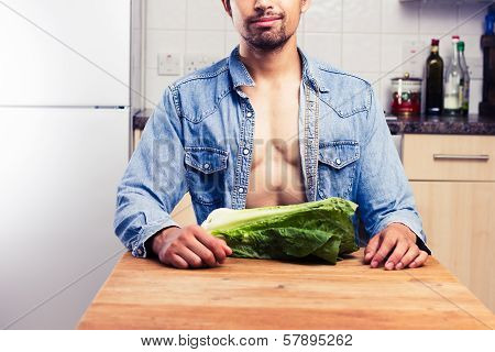Sexy Man In Kitchen With Lettuce
