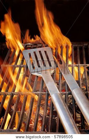 Barbecue Utensils On Hot Grill