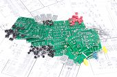 picture of transistor  - Circuit boards and electronic components with schematics in background - JPG
