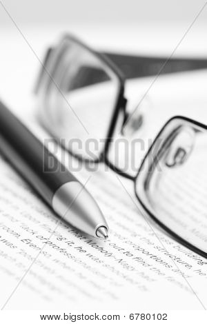 Open Book With Glasses And Pen