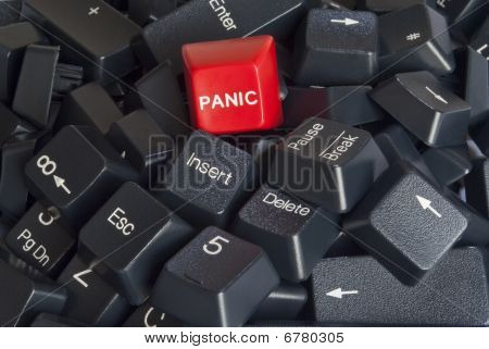 Stack Of Black Computer Keyboard Keys With Red Panic Button