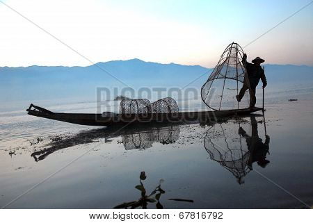 Fisherman Working In Inle Lake.