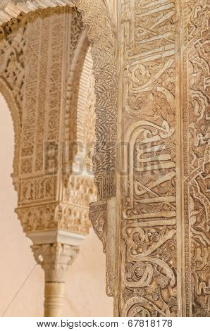 Ancient caligraphy detail in a column. Alhambra palace Granada Andalusia Spain.