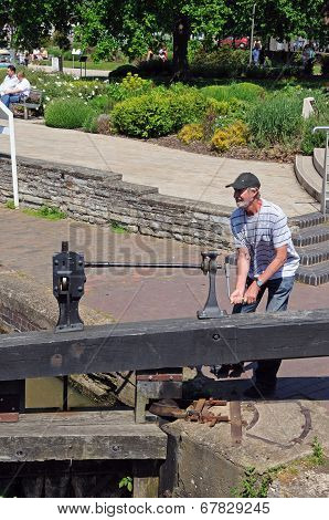 Man opening canal lock.