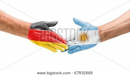 Handshake Germany and Argentina on a white background