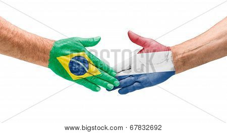Handshake Brazil and Netherlands on a white background