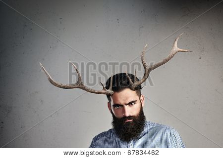 Portrait of brutal bearded man with horns