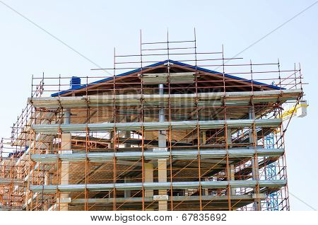 House Exterior In Construction And Crane