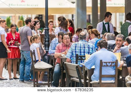 Tourists Having Lunch At Outdoor Restaurant