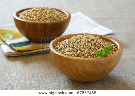 Green Raw Buckwheat In Bamboo Bowl