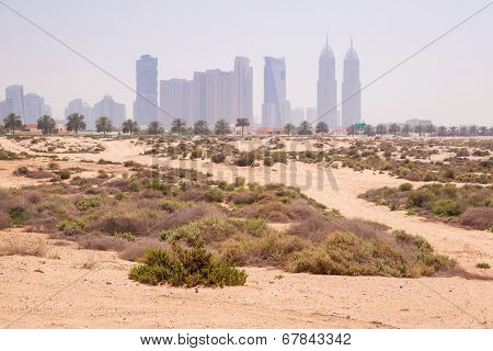 DUBAI, UAE - 1 APRIL 2014: Sandy scenery od Dubai at the Jumeirah Beach, UAE. Jumeirah Beach is a white sand beach that is located and named after the Jumeirah district of Dubai.