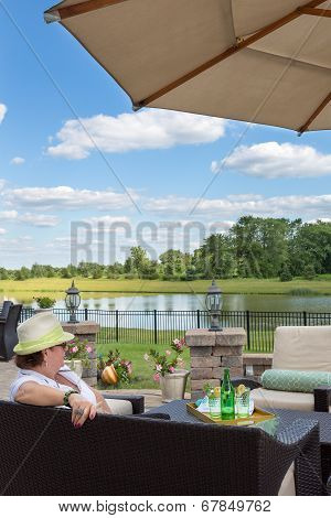 Woman Relaxing On An Outdoor Patio