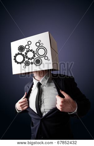 Businessman standing and gesturing with a cardboard box on his head with spur wheels