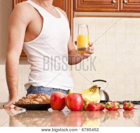 Young Man Holding Glass Of Orange Juice