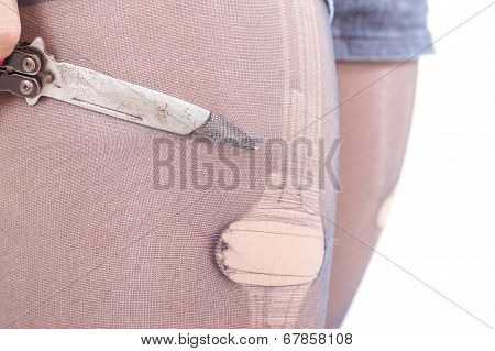 knife cutting girl's stockings