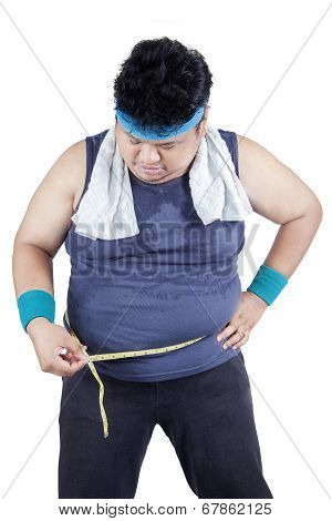 Obese Man Measuring His Belly