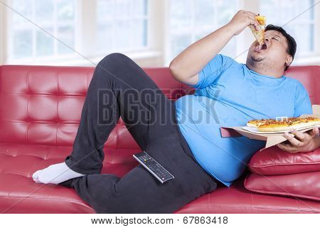 Overweight Man Eats Pizza