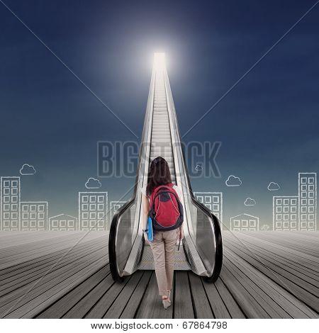 Student Walking Toward Sky
