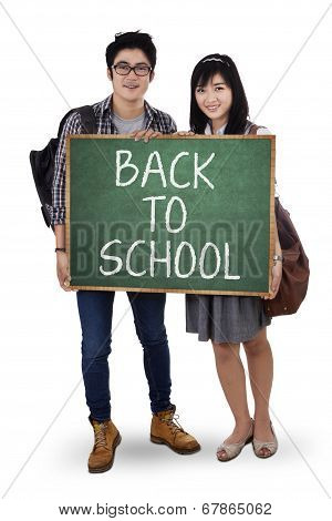 Two Student Holding Small Blackboard