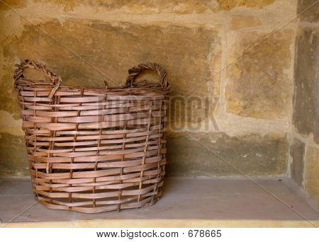 Wicker Basket In Alcove