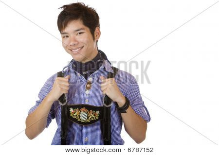Young asian man In Bavarian Oktoberfest Leather Trousers (lederhose)