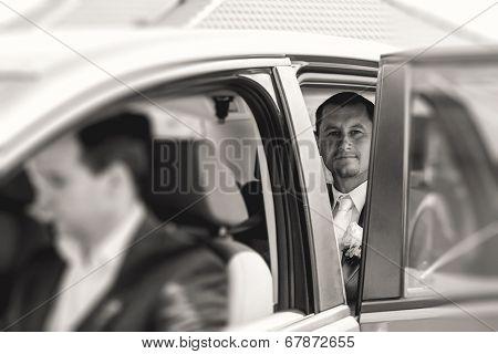 Groom Sitting In A Car