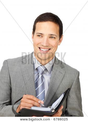 Attractive Young Businessman Holding An Agenda