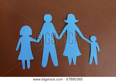 Paper family on brown background