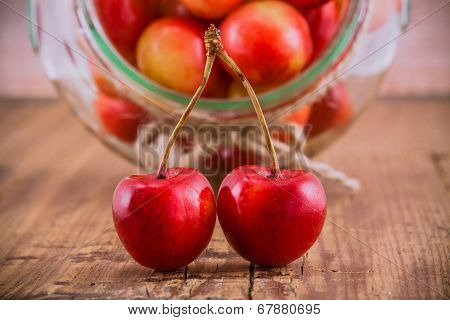 Rainier Cherries With A Bowl On Wooden Background