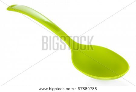 Plastic kitchen spoon isolated on white