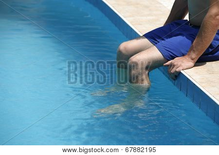 Attractive Man With Blue Swimsuit Enjoys Sun
