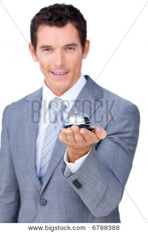 Smiling Businessman Holding A Service Bell