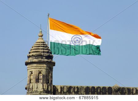 Indian flag flying over Gateway of India