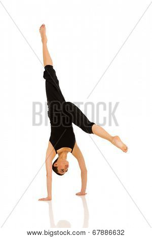 professional female dancer practicing handstand on white background