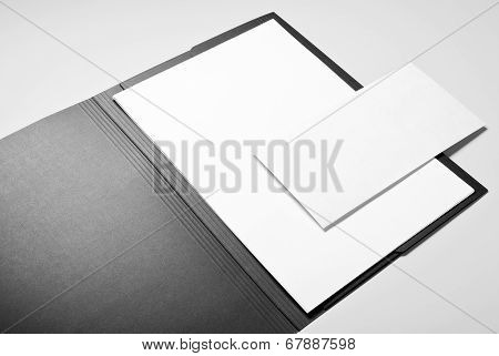 Folder, paper and envelope