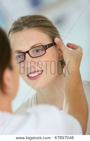 Woman trying new eyeglasses with ophtalmologist