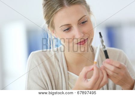 Portrait of young woman ready to opt for e-cigarette