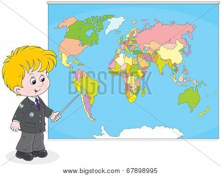Schoolboy at a World map