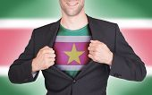 stock photo of suriname  - Businessman opening suit to reveal shirt with flag Suriname - JPG