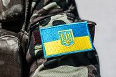 stock photo of trident  - military badge of ukrainian army with trident and yellow-blue flag