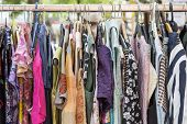 pic of flea  - clothes on a rack on a flea market - JPG