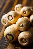 stock photo of parsnips  - Fresh parsnip on wooden table - JPG
