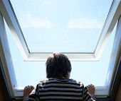 image of roof-light  - Kid at home by the roof window - JPG