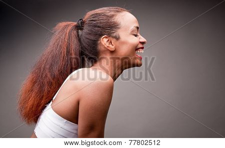 Beautiful Afroamerican Girl Laughing Under The Light