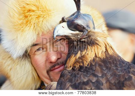 Nura, Kazakhstan - February 23: Eagle On Man's Hand In Nura Near Almaty On February 23, 2013 In Nura